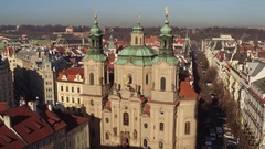 The Church of Saint Nicholas and tiled roofs old town in Prague on a sunny day Stock Footage
