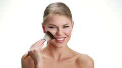 Beauty woman with makeup brush Stock Footage
