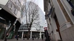 Moor House in centre of frame at  London Wall with commuters Stock Footage