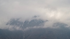 Mountain landscape with snow and cloud motion, hyper lapse video Stock Footage