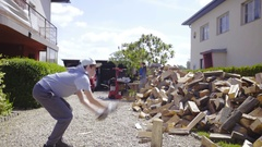 Boy split timber on ground with axe on home backyard 4K Stock Footage