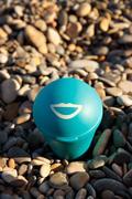 Blue beach ashtray. Stock Photos