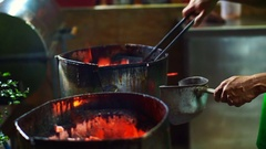 Burning charcoal on fire in stove for cooking Stock Footage