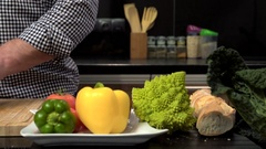 Close up on man's hands cutting courgette. Slider shot. Stock Footage