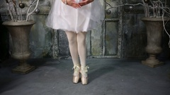 White ballet dress and toeshoe of dancing and curtsy woman near two vase. Stock Footage