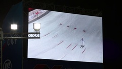Sportsman in white jumping big ramp on screen on World Cup Freestyle Stock Footage