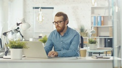Focused Young Tech Guy Interrupts Typing on His Laptop, Folds His Hands. Stock Footage