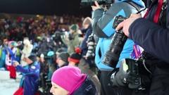 Reporters with photocamera shooting on stadium in Krylatskoye Stock Footage