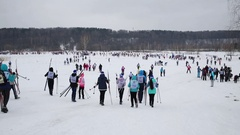 Back of people going to field near forest to competition on Ski Track Stock Footage