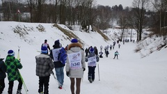 Back of people with numbers going down to field on Ski Track of Russia Stock Footage