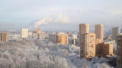 Apartment buildings near tree under winter frost and sky at day. Stock Footage