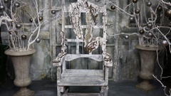 Empty old wood chair near two vase with dry branches with silvered apples. Stock Footage