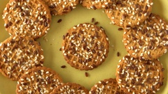 Delicious yummy freshly baked homemade cookies rotating on a green bamboo plate Stock Footage