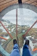 Glass floor - viewpoint at mountains Stock Photos