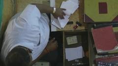 Trader making bill  (top-shot) Stock Footage