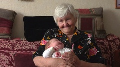 Granny keeps on hand a granddaughter Stock Footage