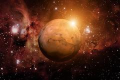 Planet Mars. Nebula on the background. Stock Photos