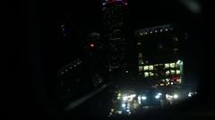 Big city night traffic jam looking in rear view mirror Boston USA Stock Footage
