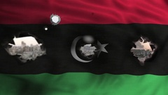 Flag of Libya with bullets holes war scenery Stock Footage