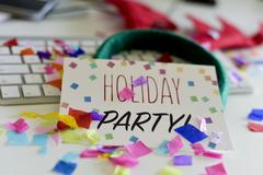 Confetti and text holiday party in an office Stock Photos