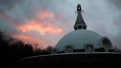 Buddhist temple dramatic sky sunset spiritual Peace Pagoda Stock Footage