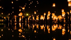 Many Sky Fire Lanterns Floating Up To The Sky And Reflection Of Thailand 2016 Stock Footage