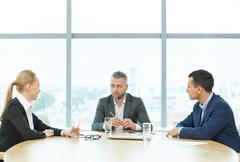 Business people negotiating in office Stock Photos