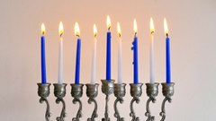 Silver Menorah with burning Hanukkah candles Stock Footage