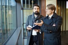 Entrepreneurs brainstorming and discussing strategies Stock Photos