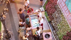 People buying ice-cream near flowerbed and fountain in GUM Stock Footage