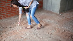 Woman drawing circle line in place of table on floor of room Stock Footage