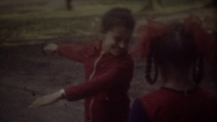 RIGA, LATVIA - SEPTEMBER 1, 1986: Children little girls jumping on a playground Stock Footage