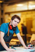 Young craftsman or repairman looking at camera during work Stock Photos