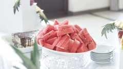 A water-melon is on a white dish, festive table Stock Footage