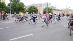 People on bicycles going from Big Krasnokholmsky Bridge Stock Footage