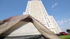 Gray tourist tent joggling on lawn near complex Losiniy Ostrov. Stock Footage