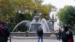 New York, USA -: People walk around City Hall or Croton Fountain Stock Footage