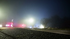 Freight train crossing foggy night time lapse blurred motion USA 4k Stock Footage