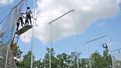 Man waving on rope and catching another one on trapeze at Luzhniki Stock Footage