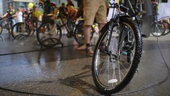 Front wheel of Stels bike washed by Karcher near others Stock Footage