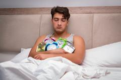 Man having trouble waking up in the morning Stock Photos