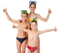 Family with three happy kids in swimsuit Stock Photos