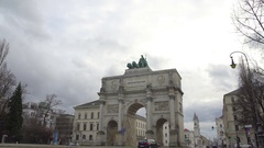 Beautiful Siegestor triumphal arch attracting tourists in Munich, Germany Stock Footage
