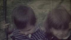 Children on swing. 8mm retro video Stock Footage