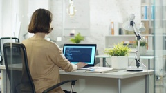 Young Creative Woman Developer Writes Code on Her Desktop Computer.  Stock Footage