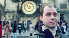Male tourist on crowded Old town square in Prague near local landmark - Stock Footage