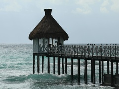 Caribbean Ocean pier yoga exercise thatch shack DCI 4K Stock Footage