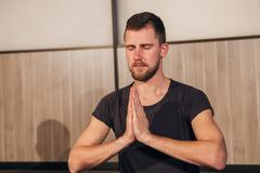 The young breaded man in the Lotus position Stock Photos