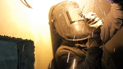 Sparks flying from welding work in new house indoors Stock Footage