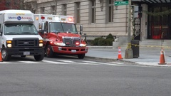 EMS Ambulance, siren, through intersection, DC, wintery Stock Footage
